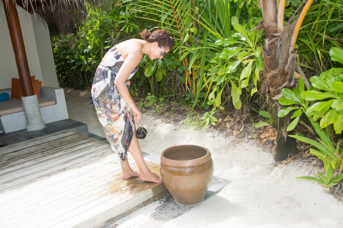 Washing the sand off of my toes in front of my beach villa :)