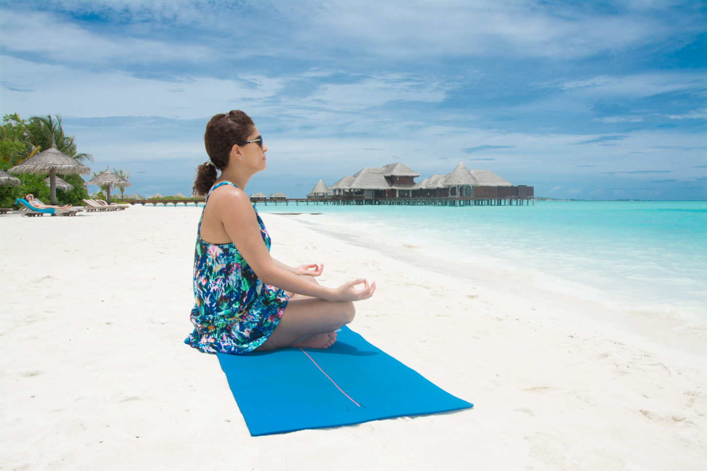 Yoga at the beach at Anantara Dhigu resort