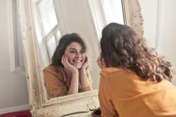 lifestyle redesign  - Looking in the mirror 250x167 - How To Use Inspired Action For Massive Dating Success